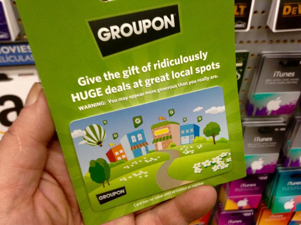 groupon gets a discount on living social deal nasdaq grpn benzinga