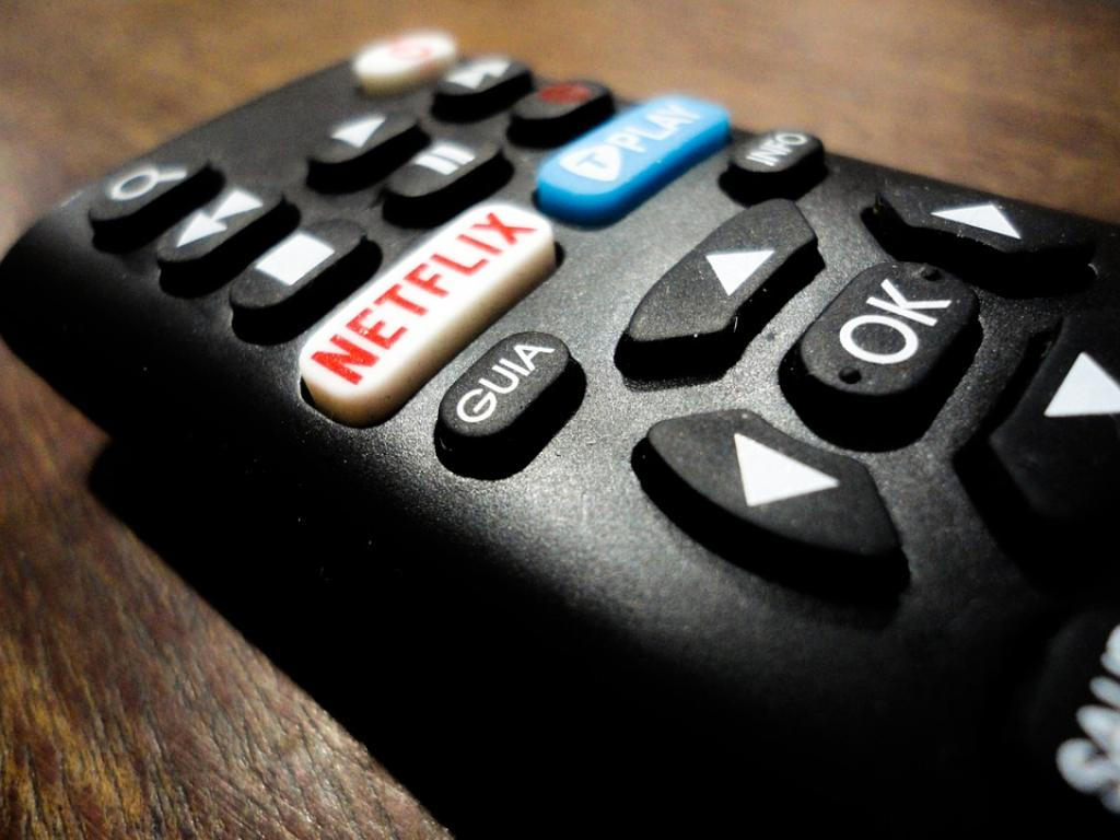 Netflix (NASDAQ:NFLX) Stock Rating Lowered by Vetr
