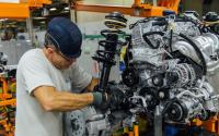A Fiat Chrysler employees prepares a Jeep Cherokee chassis at the company's Belv