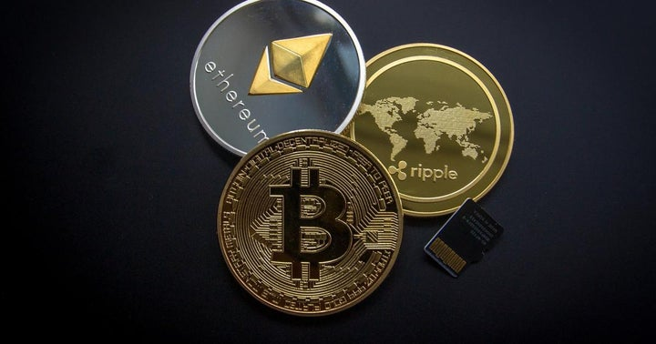 If You Invested $1,000 In Bitcoin, Ethereum, Dogecoin And Other Cryptos One Year Ago, Here's How Much You'd Have Now