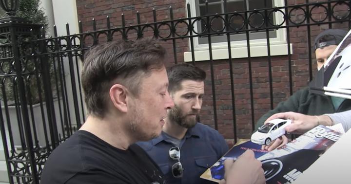 Elon Musk Autographs Toy Tesla Car, Asks Fans About Dogecoin Ahead Of 'SNL' Performance